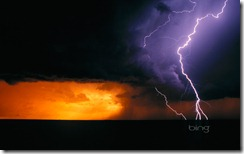 Daytime cloud to ground lightning flashes with three branches to the ground in Texas